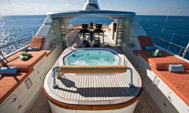 Deck Jacuzzi and seating areas on board charter yacht Marjorie Morningstar