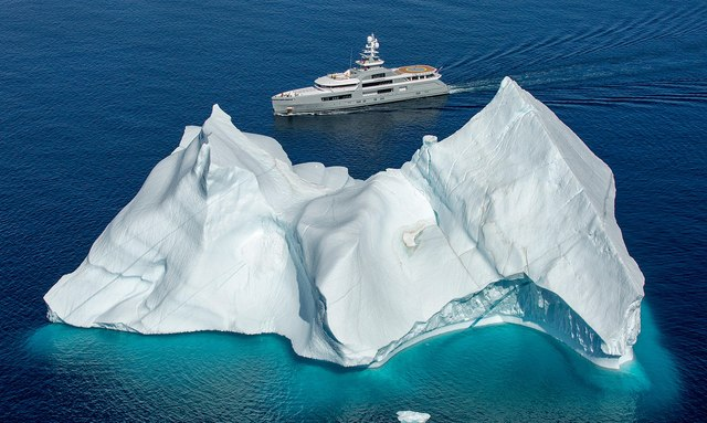 Explorer yacht CLOUDBREAK in the Artic with glacier in foreground
