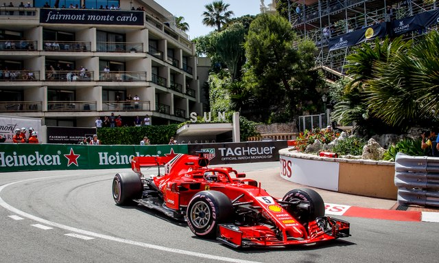 Cars speeding around the track at the f1 Monaco Grand Prix
