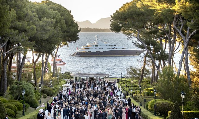 VIP guests gather for the amfAR Gala 2018 at the Eden Roc Hotel in Antibes with a superyacht at anchor not far from the shore