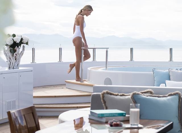Woman entering a superyacht Jacuzzi