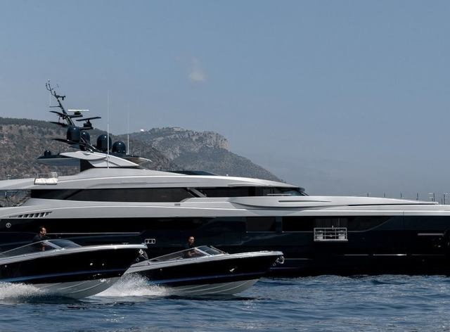 Profile shot of superyacht sarastar in the Mediterranean with tender alongside