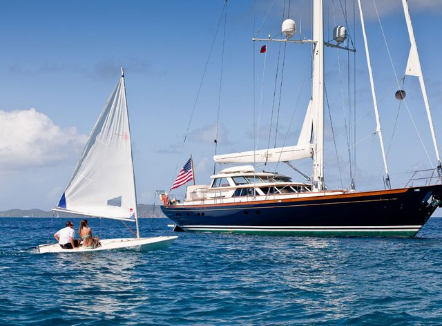sailing yacht MARAE anchors as charter guests take to the sail boat on a Caribbean yachting vacation