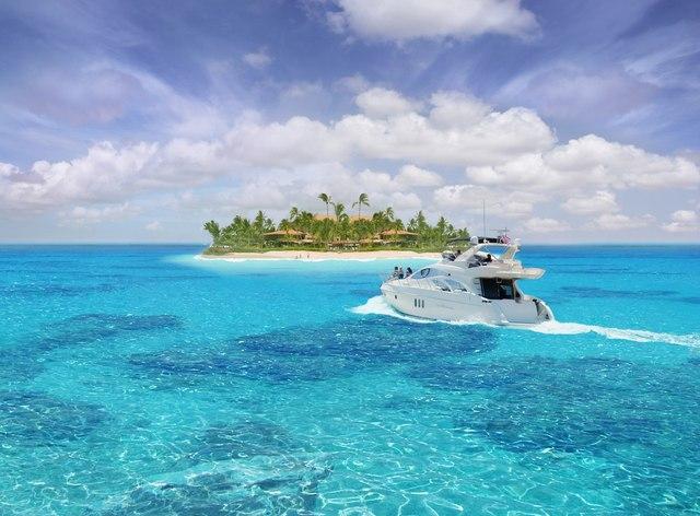 Charter yacht cruising towards an exotic island