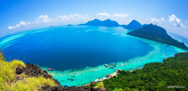 Green Malaysian coastline with hills and beautiful blue sea