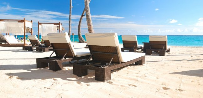 Luxurious wooden sunbeds on the beach