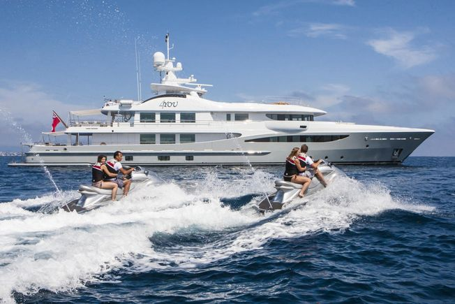 charter guests on board luxury yacht 4YOU try out the jet skis