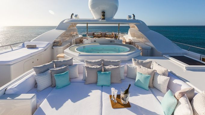 sunpads, Jacuzzi and seating areas on the sundeck of luxury yacht HANIKON