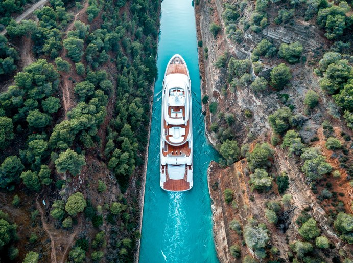 superyacht O'PTASIA cruising through the Corinth Canal on a Greece yacht charter