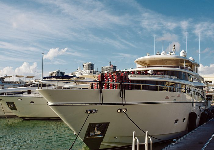 A collection of Nike Air Jordan 1 boxes stacked on the bow of a luxury yacht berthed in Miami