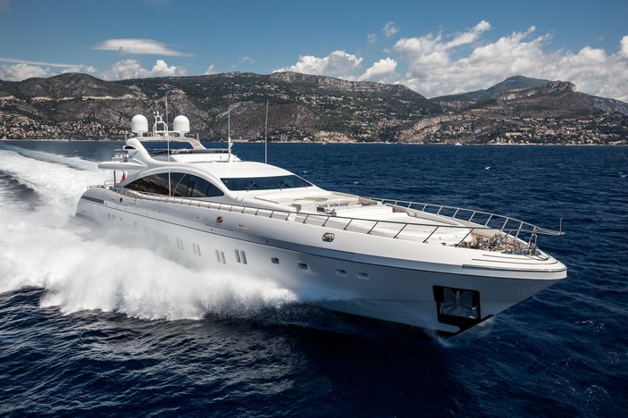 motor yacht Da Vinci cuts through the water during a Mediterranean yacht charter
