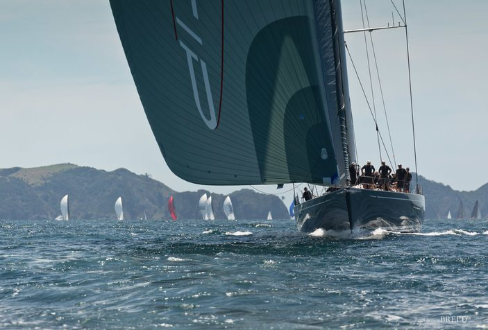 fleet of sailing yachts in action at the NZ Millennium Cup in the Bay of Islands
