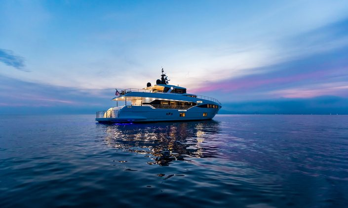 superyacht ONEWORLD anchors at night during a charter vacation in Sydney