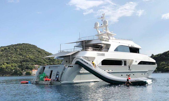 Superyacht Ottawa IV on water with large slide on outside
