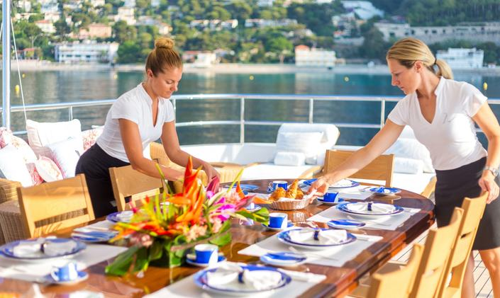 Crew serve breakfast on Feadship charter yacht W
