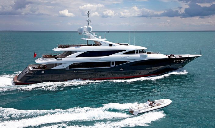 Running shot of charter yacht Liberty with tender