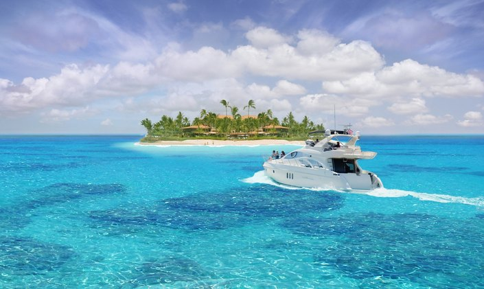 Charter yacht cruising towards an exotic island