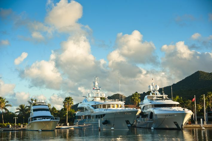 Superyachts in Simpson Bay on St Maarten, with blue sky and a few clouds behind