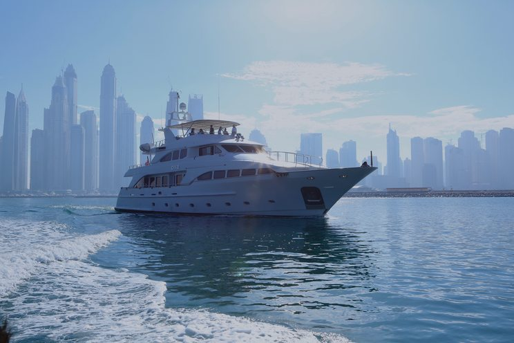 luxury yacht DXB anchors on a Dubai yacht charter