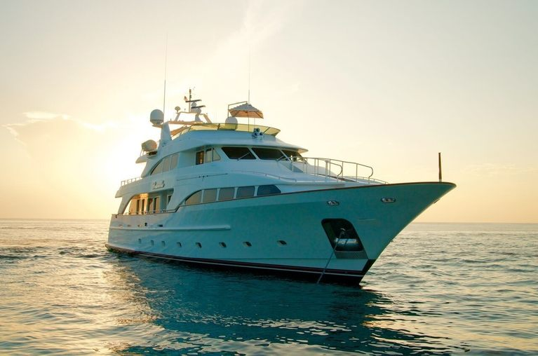 luxury yacht BRUNELLO anchors at sunset on a Caribbean yacht charter