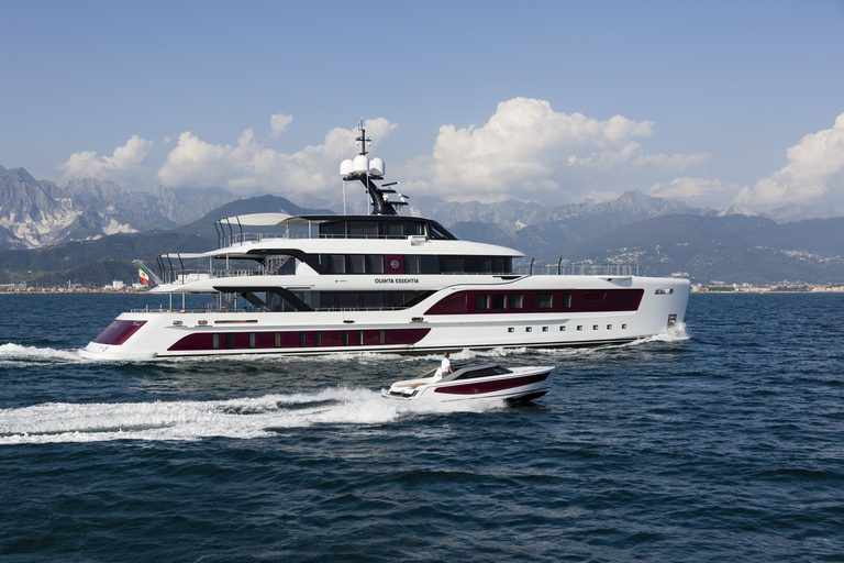 motor yacht Quinta Essentia cruises alongside its custom-made, matching tender on a Mediterranean yacht charter