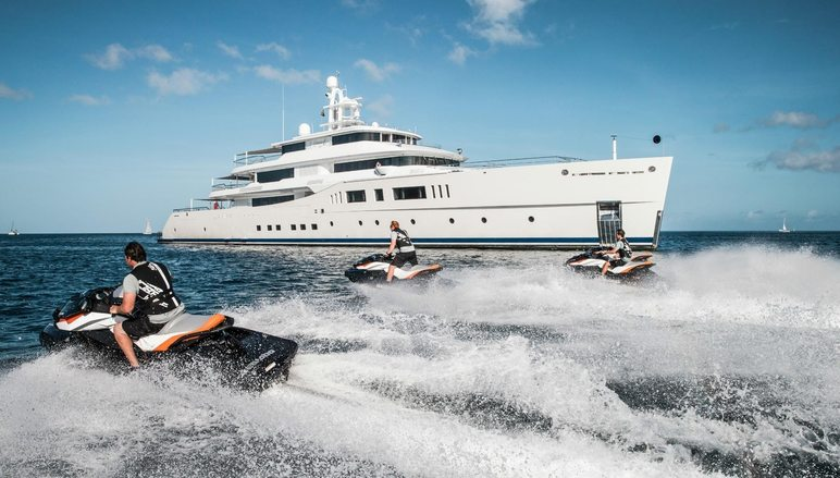 charter guests try out the jet skis with superyacht NAUTILUS at anchor