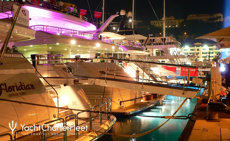 Luxury yachts at night in Monaco Harbour