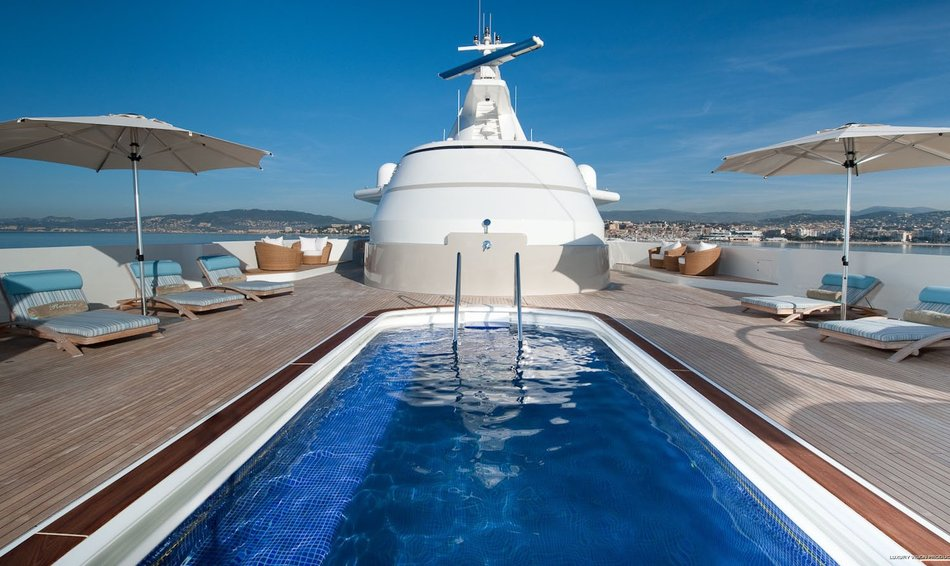 Superyacht 'Reborn's' spacious aft deck swimming pool